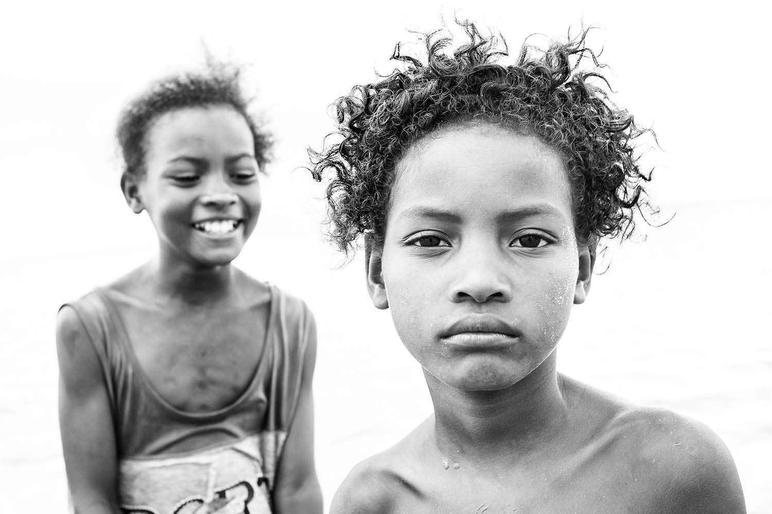 Two Vezo girls from the island nation of Madagascar, a country riddled by the legacy of colonization and climate injustice.
